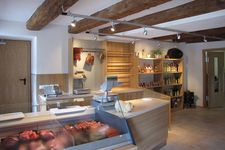 Interior design of a former stable to a farm shop with tasting room